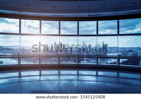 Office building glass and city skyline