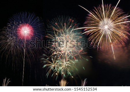 Combination of three fireworks merged into one picture