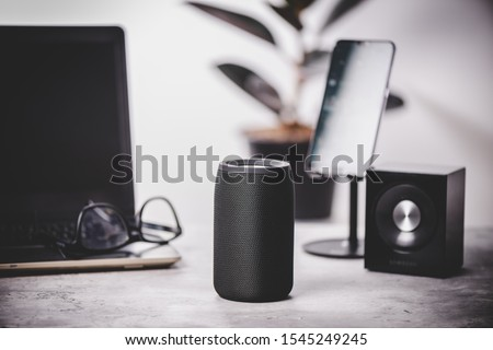 Black wireless portable bluetooth speaker for music listening. Voice assistant speaker at home. #1545249245