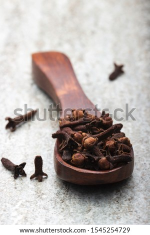 Cloves in spoon. Clove macro shot.Cloves image (long image) #1545254729