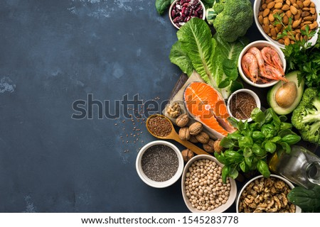 Food sources of omega 3 on dark background with copy space top view. Foods high in fatty acids including vegetables, seafood, nut and seeds. Health food fitness #1545283778