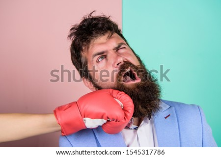 Teeth pain concept. Defenseless head. Suffering. Punch in face. Destroy beauty. Cosmetology and plastic surgery services. Strong punch. Hand in boxing glove punching bearded male face. Painful punch. Royalty-Free Stock Photo #1545317786