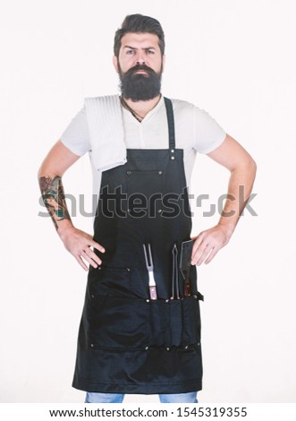 Bearded hipster wear apron for barbecue. Roasting and grilling food. Tips cooking meat. Tools for roasting meat outdoors. Picnic and barbecue. How choose meat for steak and barbecue. Barbecue menu. #1545319355