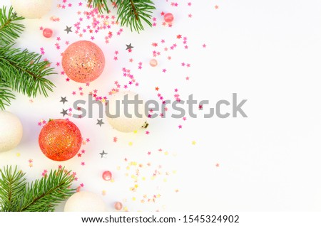 Flat lay Fir branches with Christmas decorations and confetti on a white background frame mockup with copy space for text or Xmas banner #1545324902