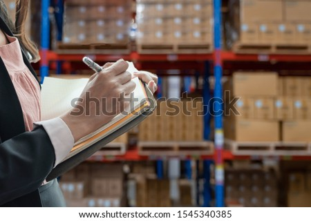 Beautiful businesswoman Taking notes Product details In product chainsaw Check order Deliver products to customers #1545340385