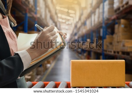 Beautiful businesswoman Taking notes Product details In product chainsaw Check order Deliver products to customers #1545341024