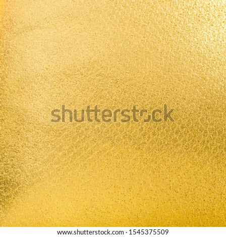 Shiny yellow gold fabric texture. Surface, pattern of rough abstract cloth matte background. Design in your work decoration backdrop, concept copy space for text. #1545375509