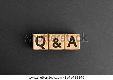 Q&A - acronym from wooden blocks with letters, questions and answers Q&A concept,  top view on grey background #1545411146