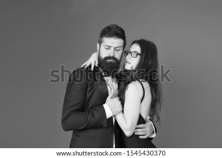 Lets dance tonight. Elegant couple in love tender hug dancing red background. Feel rhythm of heart. Happy together. Man in tuxedo and woman black dress dancing at party. Passionate couple dancing. #1545430370