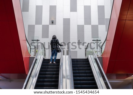 Modern escalator with people for facilities in a contemporary building #1545434654
