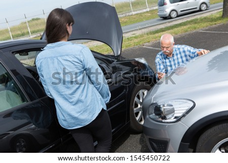 two drivers arguing after traffic accident #1545450722