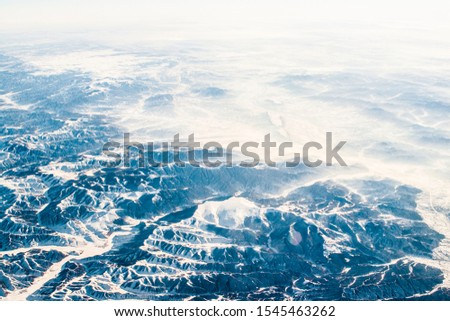 Wintertime mountains and farmlands in midland China #1545463262