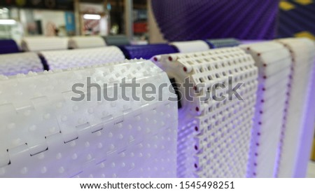 Mass production plastic conveyor used in industrial machines. #1545498251