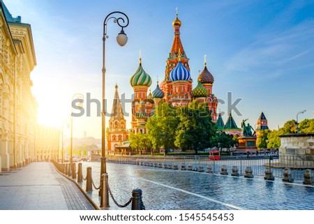 Morning city landscape with view at Cathedral of Vasily the Blessed (Saint Basil's Cathedral) on Red square. Sunlight of Dawn Illuminates Domes. Moscow, Russia. #1545545453