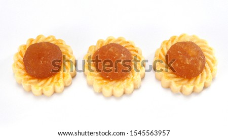 Pineapple tarts or nanas tart are small, bite-size pastries filled or topped with pineapple jam #1545563957