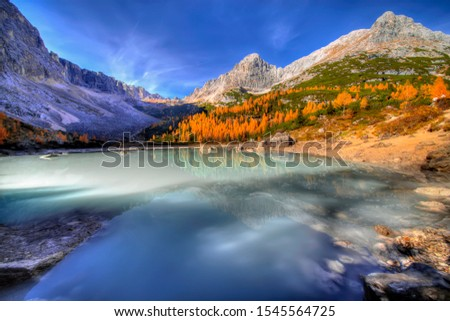 Turquoise Sorapis Lake near Cortina d'Ampezzo, with Dolomite Mountains and Forest - Sorapis Circuit, Dolomites, Italy, Europe, autumn picture.