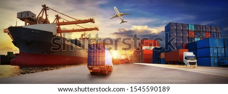 Container truck in ship port for business Logistics and transportation of Container Cargo ship and Cargo plane with working crane bridge in shipyard, logistic import export and transport   #1545590189