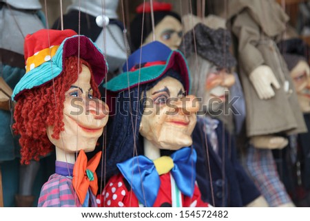 Wooden marionette puppets for a children theater #154572482