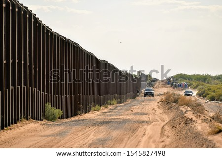 Border fencing along New Mexico's international border with Mexico. Royalty-Free Stock Photo #1545827498