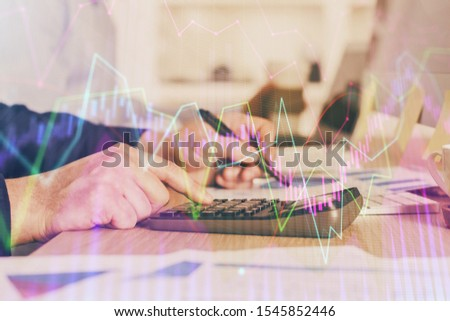 Financial trading graph multi exposure with man desktop background. #1545852446