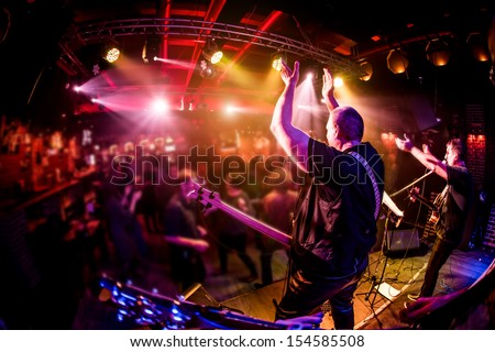 Band performs on stage, rock music concert Royalty-Free Stock Photo #154585508