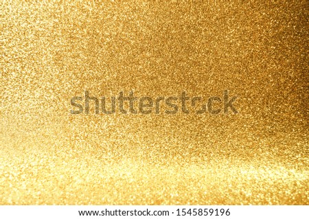 Gold,yellow abstract light background,Gold bokeh shining lights,sparkling glittering Christmas lights.Season greeting background.New year Luxury backdrop image.Blurred abstract holiday background. #1545859196