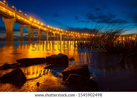 Bridge. Illumination of a bridge with a freeway. Bridge over the bay at night. Construction of bridges. Road Architecture. City infrastructure. Reflected in the water. Saint Petersburg. Russia.  #1545902498