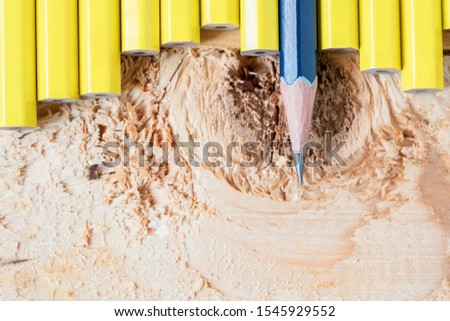 Think differently business concept. blue pencils on wooden background #1545929552