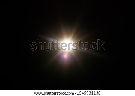 Lens Flare. Light over black background. Easy to add overlay or screen filter over photos. Abstract sun burst with digital lens flare background. Gleams rounded and hexagonal shapes, rainbow halo. #1545931130