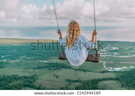 Beautiful view of young woman swing on the top of the mountain Redonda in Dominican Republic. Concept travel, vacation #1545944189