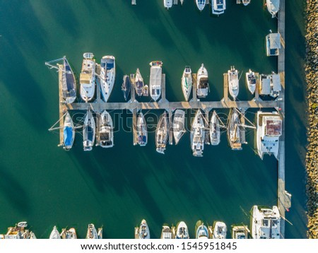 Boats docked up in a marina #1545951845