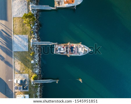 Boats docked up in a marina #1545951851