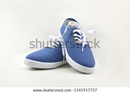 Blue sneakers on white background. #1545957737
