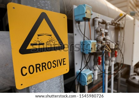 Dangerous corrosive warning sign and symbol applying where chemical substance storage used