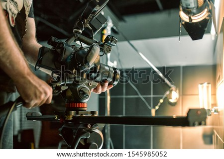 Behind the scenes of filming films or video products and the film crew of the film crew on the set in the pavilion of the film studio. #1545985052