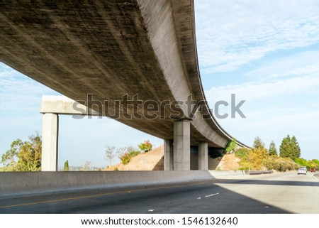Underside view of freeway at a freeway interchange in East San Francisco bay area, California #1546132640