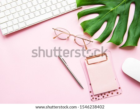 Office desk working space - Flat lay top view  of working space with keyboard and notebook  on pink pastel background. #1546238402