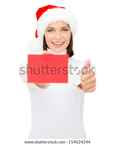 christmas, x-mas, people, advertisement, sale concept - happy woman in santa helper hat with blank red card showing thumbs up #154624244