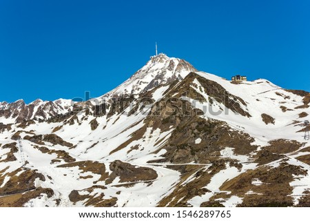 view on the Pic du Midi de Bigorre with white snow against cloudless blue sky on sunny day in nature
