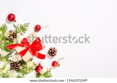 Christmas flat lay background with fir tree, present box and decorations with light bokeh. Free space for design. #1546291049