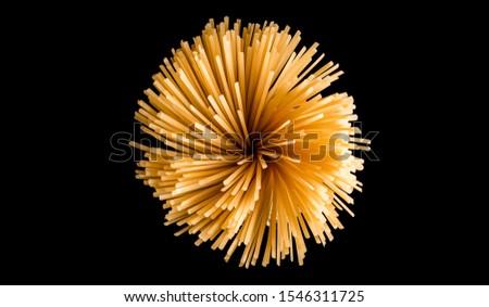 Italian spaghetti , creative pic taken on a black background. Spaghetti like fireworks.