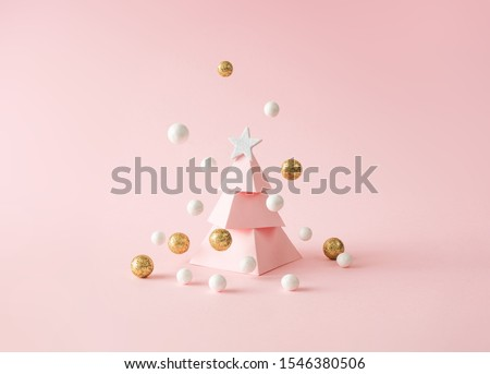 Christmas composition. Pink Christmas tree, with decoration on pink background. Happy holidays. new year minimal concept. #1546380506