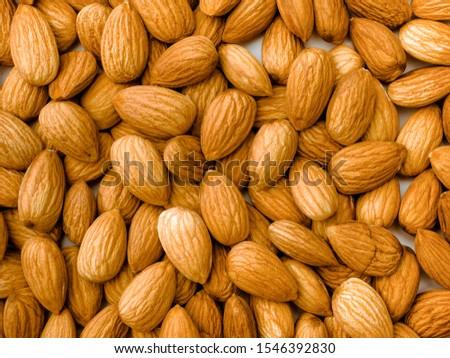 Almonds texture, nut bsackgtound. Top view. #1546392830