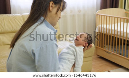 Newborn baby child lay and sleep on mother arms, fragile life #1546443176