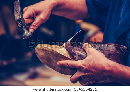 Shoemaker workshop for making shows artisan handmade manufacturing leather shoes. Shoe manufacture business for traditional vintage shoe making, craft shoes in traditional style Royalty-Free Stock Photo #1546554251