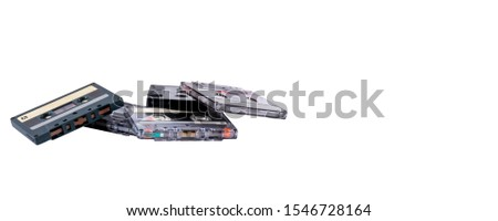 Old cassette tapes in a heap isolated on white background. Banner or head style image