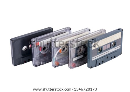 Old cassette tapes in a heap isolated on white background