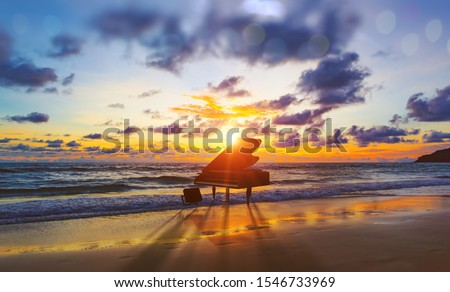 Music background.Melody and song concept in nature.Surreal image of grand piano in scenic sunset beach