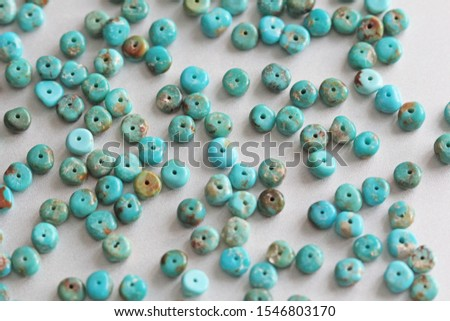 Stone Turquoise. Natural Turquoise Stone, Round beads. Turquoise mineral raw background. #1546803170
