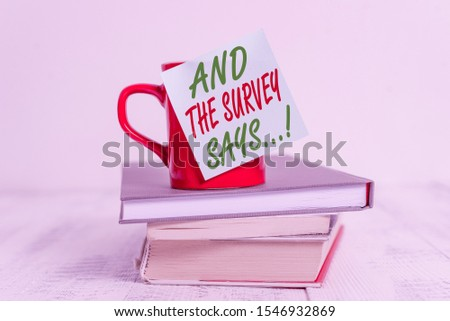 Conceptual hand writing showing And The Survey Says. Business photo text written spoken results of short quiz or exam on internet Coffee cup sticky note stacked books retro old retro wooden table. #1546932869